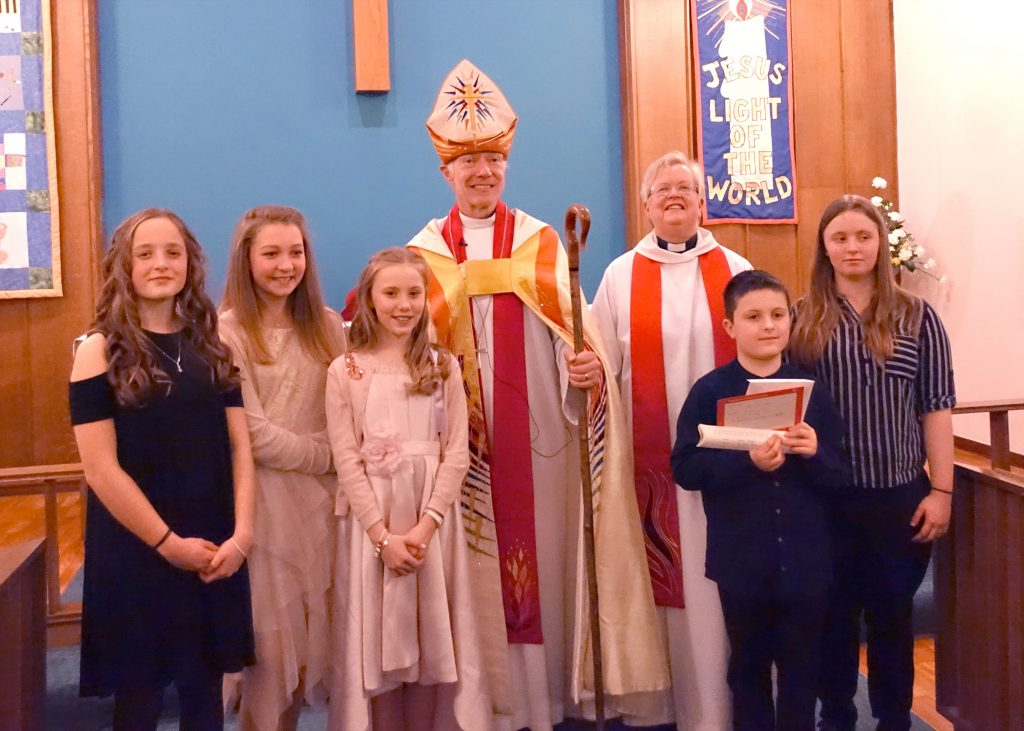 Newly confirmed with vicar and bishop