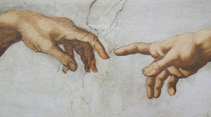 Detail of creation of Adam by Michelangelo in the Sistine Chapel